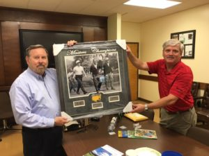 Jim Huff and Steve Lambert display items available for silent auction