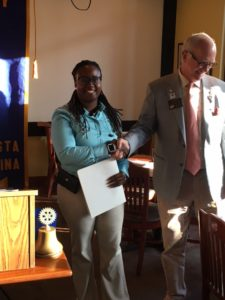 District Governor, Lance Young, welcomes Shannon Wood as a new member the North Augusta Rotary Club.