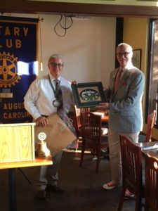 Club president Keith Muehlfeld presents the District Governor Lance Young with a gift from the Club.